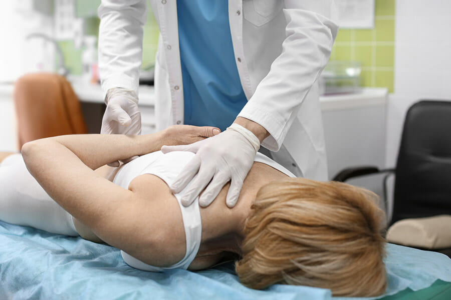 Oakville Chiropractor shoulder treatment on a female patient